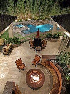 pool, hot tub, patio & fire pit, set against a small backyard, possibly terraced.