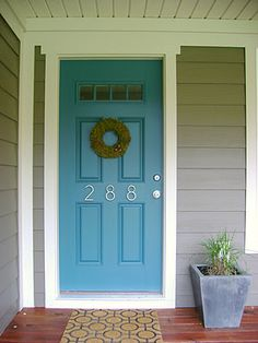 House exterior -grey and blue door. Love this but not sure it would go w the pewter green accent...