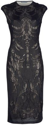 Alexander McQueen - skeletal black mesh silk lace pencil dress. (Annoying girly t-shirt sleeves, but nice neckline. Overall: hot.)