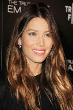 """She has a beautiful mixture of dark and lighter brown with some flecks of blonde,"" says Balding. Jessica's color is a very tame version of a new trend called splashlighting, in which the lightest highlights hit at mid-shaft for  a shiny, reflection-like effect .   - Redbook.com"