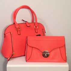 Faux Leather Satchel w/ removable clutch Gain 2-in-1 versatility with this two-tone Coral Rivet satchel. Richly designed with a pebbled exterior and gleaming gold-tone hardware, it's perfect for all your dressed-up occasions. Features a fantastic zip-off clutch that includes a wristlet, so you can downsize at a moment's notice. Offers the best of fashion and convenience in one gorgeous handbag. Wilsons Leather Bags Satchels
