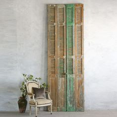 """Wonderfully distressed vintage shutters in a chippy green finish. These would make a wonderful dressing screen, head board or wall art. One pair available. Please note that item does not have hardware for mounting.    • 119""""H x Range of 9.5-10.25"""" W (per panel)  • Circa: 1940"""