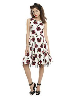 "<p>White sleeveless swing dress with a hot pink, black and yellow floral print, V-neckline and black tulle underlay. Side zipper closure.</p>  <ul> <li>Model wearing size small</li> <li>37"" long from shoulder</li> <li>97% cotton; 3% spandex</li> <li>Wash cold; line dry</li> <li>Imported</li> </ul>"