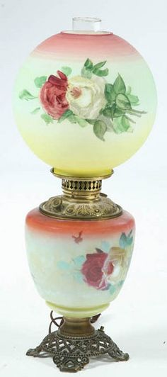 lighting, America, An unattributed parlor lamp having a pierced brass base, milk glass Gone with the Wind shades and hand painted floral decoration. Circa 1876-1925