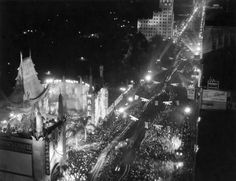 """Whenever I see a spectacular photo of Grauman's Chinese Theatre that makes me go """"Wow! Which premiere that was for?"""" almost invariably it turns out to be the taken the night of the spare-no-expense night that Howard Hughes's """"Hell's Angels"""" opened. The caption to this photo says that they had 200 searchlights(!!) as well as smokescreens in the sky onto which the film screen title was projected. I've never heard that before, and it was probably hard to photograph, but I'd love to have seen…"""