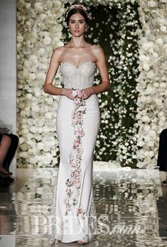 Brides: Reem Acra - Fall 2015. Strapless cream silk georgette wedding dress with cutout skirt detail and sweetheart neckline, Reem Acra