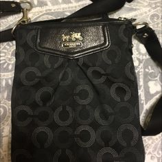 Cross body coach purse Small cross body coach purse. Black with a hint of white and a dark turquoise inside! In great condition! Coach Bags Crossbody Bags