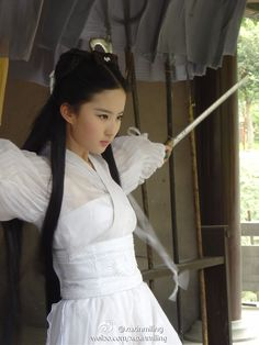 the50-person practically the four main dresses liu yi fei's xiao long nu wears. been wanting to do a post on her costumes for some time so...