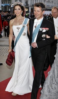 Crown Princess Mary of Denmark   wearing the tiara, stomacher and possibly bracelet from the Danish Ruby parure.