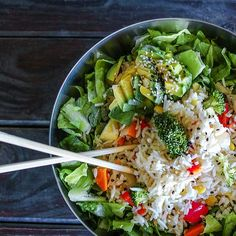 Tonight's dinner is mix veg rice on a bed of crispy lettuce topped with sesame avocado