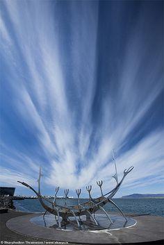 Dynamic sky over The Sun Voyager in Reykjavik, Iceland