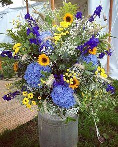 Rustic vintage milk churn arrangement with sunflowers for an Autumn farm wedding by Jenny Fleur