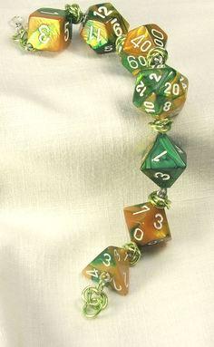 Gamer Bracelet D20 Bracelet Gold and Green Swirl Geek Nerd RPG Larp Jewelry.  via Etsy.