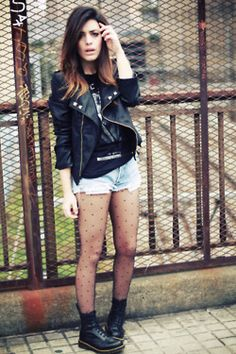 Doc, moto jacket, dotted tights & ripped shorts.