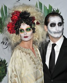 Debra Messing and husband actor/screenwriter Daniel Zelman attend the 16th Annual Bette Midler's New York Restoration Project's Hulaween at The Waldorf Astoria on October 28, 2011 in New York City.