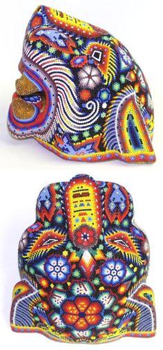 Huichol Bead Art, Mexico It's decided, I need a fake jaguar head in my life.