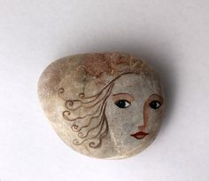 Painted stone. painted pebble. Beach