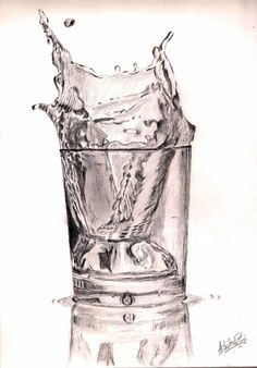 ice cube dropping in glass of water