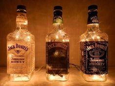 Jack Daniels bottles with white lights - A perfect man-cave addition. Jack Daniels bottles with white lights - A perfect man-cave addition. Festa Jack Daniels, Jack Daniels Bottle, Jack Daniels Wedding, Jack Daniels Party, Alcohol Bottles, Wine Bottles, Liquor Bottle Lights, Glass Bottles, Bottle With Lights