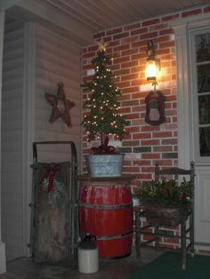 Christmas porch. Like the tree in a bucket