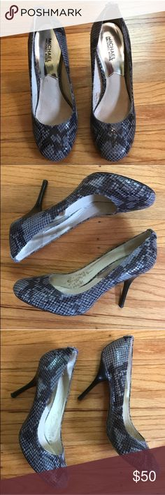 Michael Kors Snakeskin Pumps, size 8.5 These snakeskin heels are perfect for any wardrobe! Size 8 1/2. There are some spots/stains inside the shoe but none on anything that is visible during wear. MICHAEL Michael Kors Shoes Heels