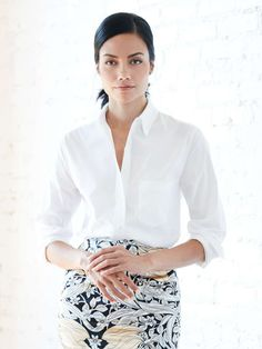 You deserve wardrobe pieces that are as hardworking as you. Case in point: the timeless white button-down. Pair a slightly oversized fit (remember, it's a good thing if it looks like you pulled it from his closet) with a graphic pencil skirt and pointy-toed black pumps for a statement as polished as your portfolio.