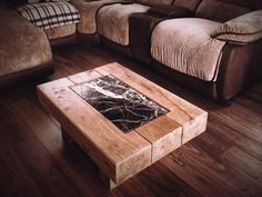Pobbles Railway Sleeper Table, a chunky solid oak interior coffee table combined with stressed granite centre.