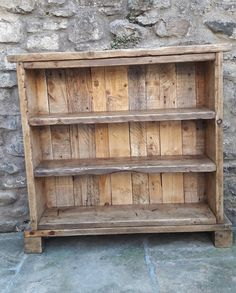 This is a solid wood handmade bookcase. The main body is made from reclaimed scaffold boards and the back panel is made from reclaimed pallet boards. The back is made up of different age, size and colour planks which gives it a one off handmade feel and the scaffold boards still