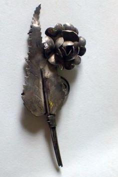 Silver Flower Brooch   $65  Dealer #282  Lula B's  1010 N. Riverfront Blvd. Dallas, TX 75207  Open Daily Mon. -- Sat. 10 to 6 Sun. 12 to 6  Like us on Facebook: https://www.facebook.com/