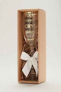 """This sweet champagne flute asks bridesmaids to stand by your side in pretty gold and black script. The glass reads, """"Plan with me, stand with me, cry with me, laugh with me. Will you be my bridesmaid?"""" Features and Facts:  Glass  9.5""""H x 3""""D; Holds 7oz  Hand wash  Comes packaged in gift box"""