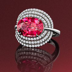 Oval rubellite and diamond cluster ring in 18ct white gold