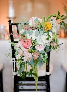 Beautiful chair decor for the bride and groom.