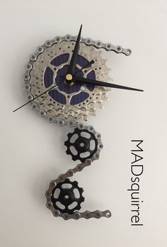 A personal favourite from my Etsy shop https://www.etsy.com/uk/listing/400764813/triple-sprocket-and-jockey-wheel-clock