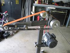 Belt Grinders by MOBI-DICK -- Homemade belt grinder constructed from square steel tubing. Powered by a 2 HP motor. http://www.homemadetools.net/homemade-belt-grinders-3