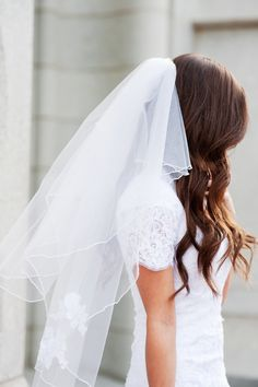 Adore this veil with delicate lace flower applique