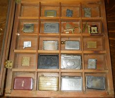 Stamp Holders and small souvenir book shaped albums with accordion style photos of a city. A couple book shaped holders are small picture frames.  Judith Walker's Collection