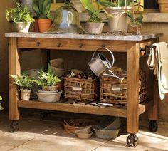 Simple Potting Bench I like this one because it has wheels