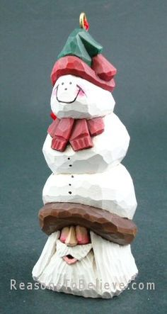 Snowman Santa ornament--Dave Francis original Santa carving. Hand carved and hand-painted Santa Claus ornament made from bass wood. Signed by Canadian woodcarver, Dave Francis.