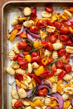Crispy Sheet Pan Gnocchi and Veggies A one-pan dinner of roasted gnocchi and vegetables that doesn't even require you to boil the dumplings. - Recipe: Crispy Sheet Pan Gnocchi and Veggies — Quick and Easy Vegetarian Dinners Vegetarian Recipes Dinner, Veggie Recipes, Healthy Recipes, Easy Recipes, Veggie Dinners, Free Recipes, Vegetarian Cooking, Chicken Recipes, Dessert Recipes