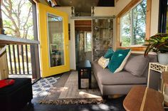 It may be enough to convince some tiny house critics out there: determined to keep a regular-sized refrigerator, stove, washer-dryer, a patio and enough space to entertain, this couple's tiny home - built on an extra-wide trailer - feels positively large.
