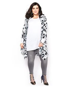 Go for a playful monochrome look with this stunning plus-size kimono from Melissa McCarthy. It has an abstract floral print, open front and 3/4 sleeves with cuffs. A chic addition to your spring work wardrobe!