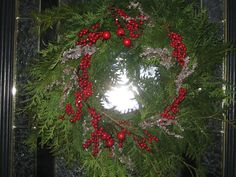 Fresh Cedar Wreath for my door this year instead of the boxwood.  Great tip use the small wreath from the $ store and cut cedar and insert.