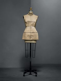 """Maison Margiela (French, founded 1988). Martin Margiela (Belgian, born 1957). Waistcoat, spring/summer 1997, Semi–Couture. Machine–sewn natural linen plain weave, hand–stamped with Stockman dummy text: """"SEMI COUTURE,"""" """"PARIS/BREVETTE S.G.E.G/35059,"""" and """"42,"""" hand–sewn hook–and–eye closures. Photo © Nicholas Alan Cope. #ManusxMachina #CostumeInstitute"""