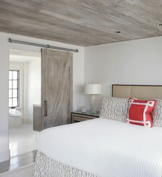 Low Ceilings, No Problem: 8 Ways to Keep Not-So-Tall Rooms Stylish A modern version of the look is seen in this Florida bedroom. Keeping the ceiling, barn door, and bathroom vanity the same material creates flow and s. Room, House, Low Ceiling, Interior, Home, House Ceiling Design, Bedroom Design, House Interior, Coastal Bedrooms