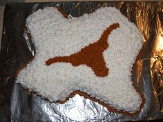 Texas Longhorn cake - We live in Texas and my husbands boss likes OU so when Texas won, I made him a cake, it was great.