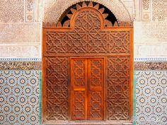 Delicate decorationin the zellige of theBou Inania Madrasa. Fez, Morocco