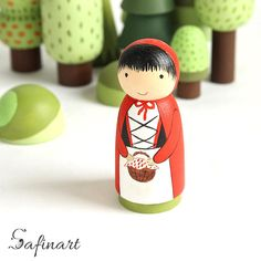 Peg dolls Little Red Riding Hood. Little Red Riding Hood wooden dolls for imaginative play or to interior decoration. Each item is hand painted and finished in a acrylic varnish. If you want another character from another fairy tale, please contact my shop and I will be happy to see what