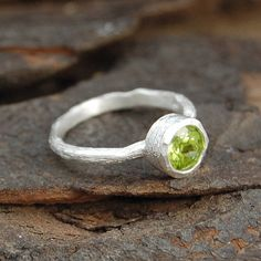 silver textured single peridot gemstone ring by embers | notonthehighstreet.com