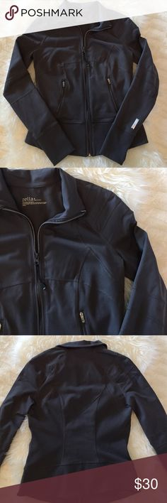 Zella (Nordstrom) Zip Up Running Jacket Excellent condition, worn only a few times.  No stains, holes or pilling.  Charcoal gray, thumb holes, zippered pockets with hole for headphones.  88% polyester, 12% spandex.  Fits true to size. Zella Jackets & Coats