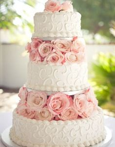 I like this cake! but different flowers, maybe tighter roses and with lavender and white mixed in